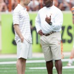 Shaka Smart and Charlie Strong before the UT Spring game. (Will Gallagher/IT)