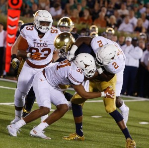 Kris Boyd and Jason Hall tackle Notre Dame. (Will Gallagher/IT)