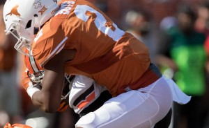 Kris Boyd tackles Oklahoma State. (Will Gallagher/IT)