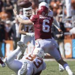 Paul Boyette wraps up Baker Mayfield. (Will Gallagher/IT)