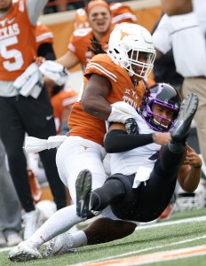 Malik Jefferson on the tackle (Will Gallagher/IT)