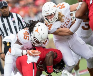 Malik Jefferson and Breckyn Hager team up on the tackle. (Will Gallagher/IT)