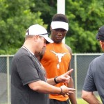Tom Herman and DeMarvion Overshown talk during UT's Satellite camp at ETBU. (Justin Wells/IT)