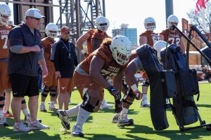 Herb Hand and the offensive line (Will Gallagher/IT)