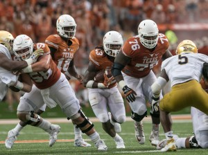 D'Onta Foreman follows Kent Perkins and Zack Shackelford (Will Gallagher/IT)